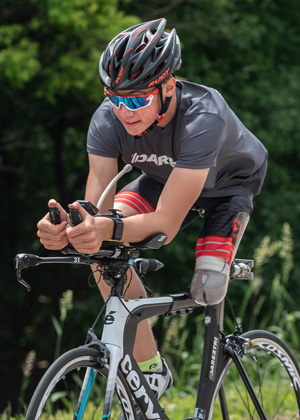 Athlete Jack O'Neil cycling in a Dare2tri kit.