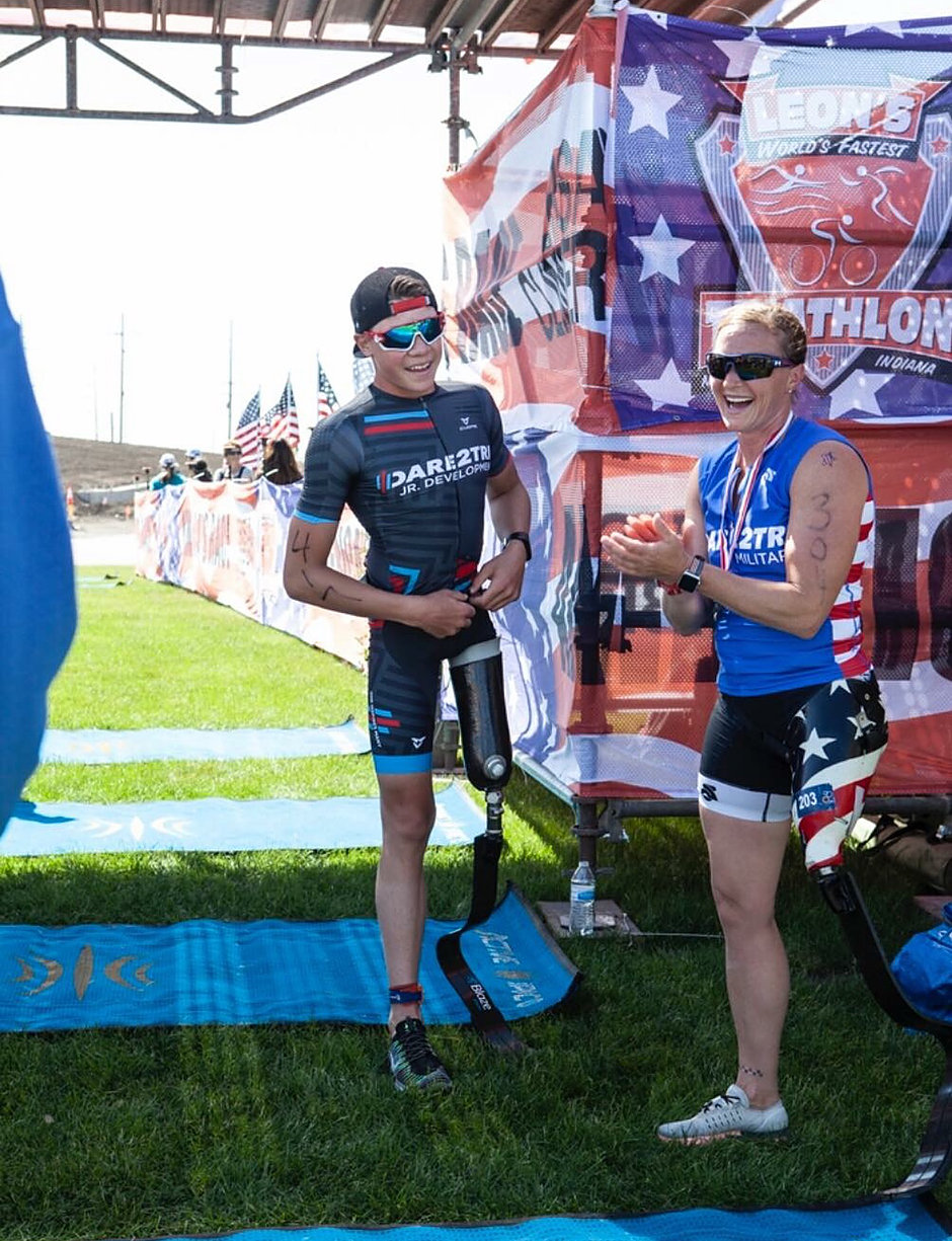 Jack O'Neil and Melissa Stockwell at the finish line of Leon's Triathlon.