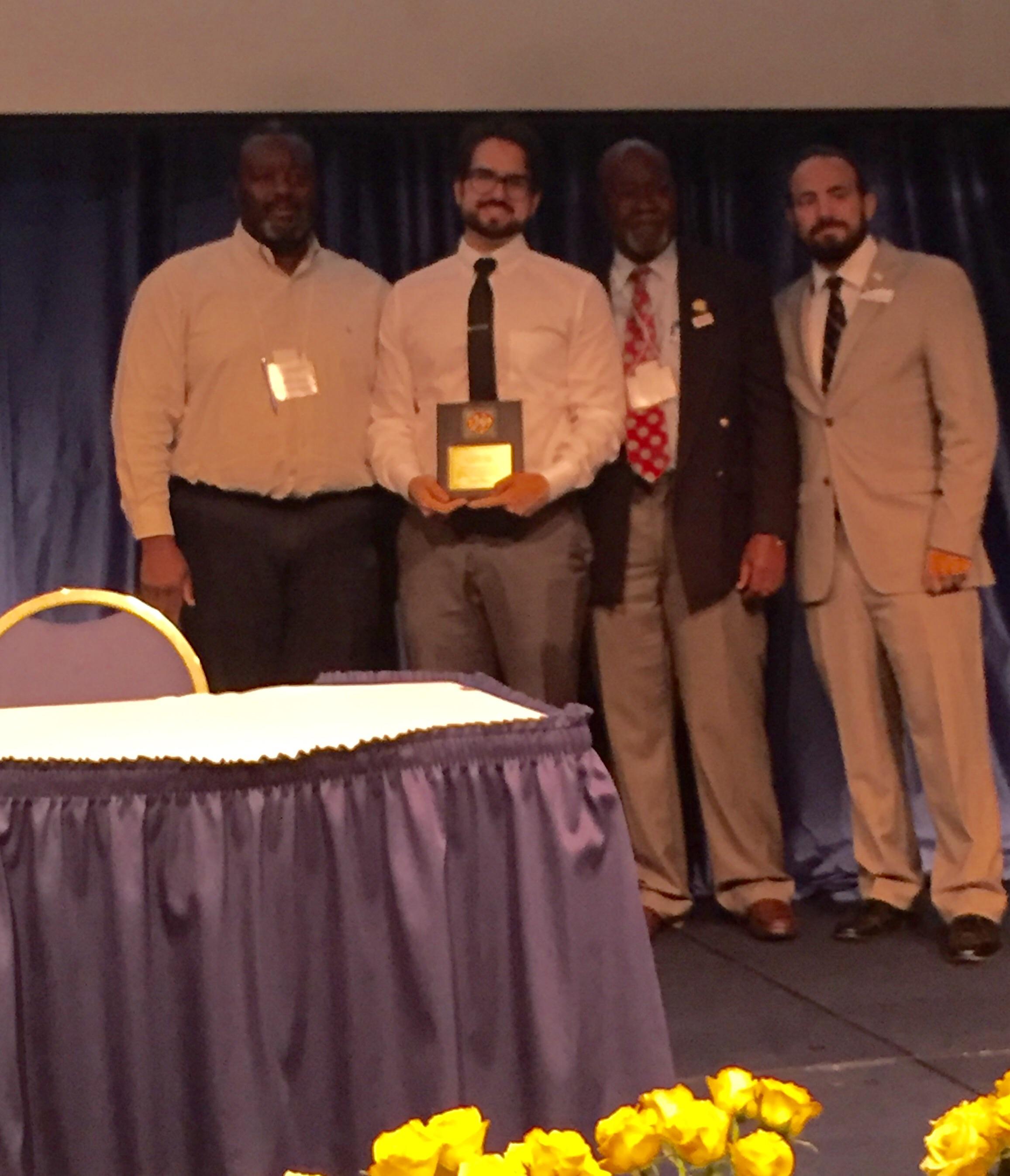 Reinier accepting his award