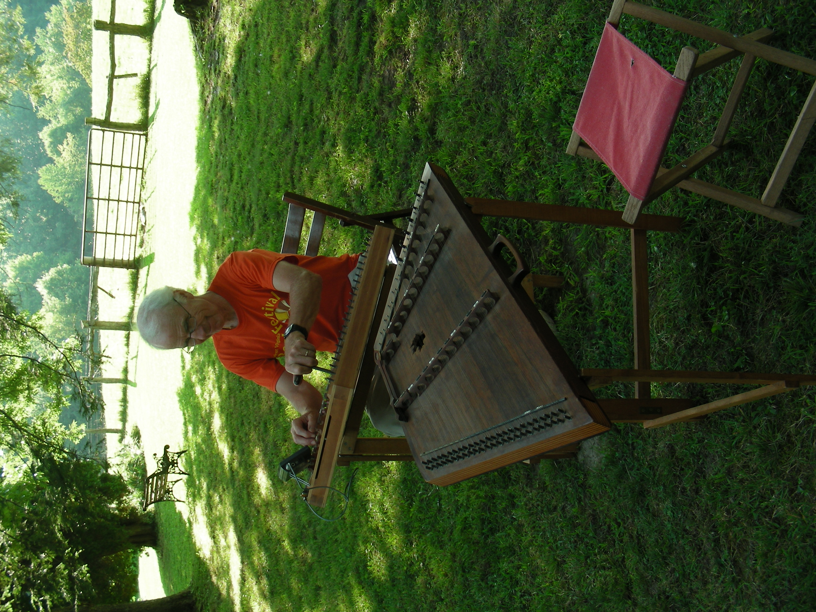 John tuning the hammered dulcimers in the yard