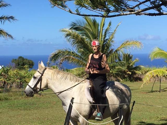 Jim Warthman fulfilling his wish to ride a white horse. PHOTO: North Hawaii Hospice