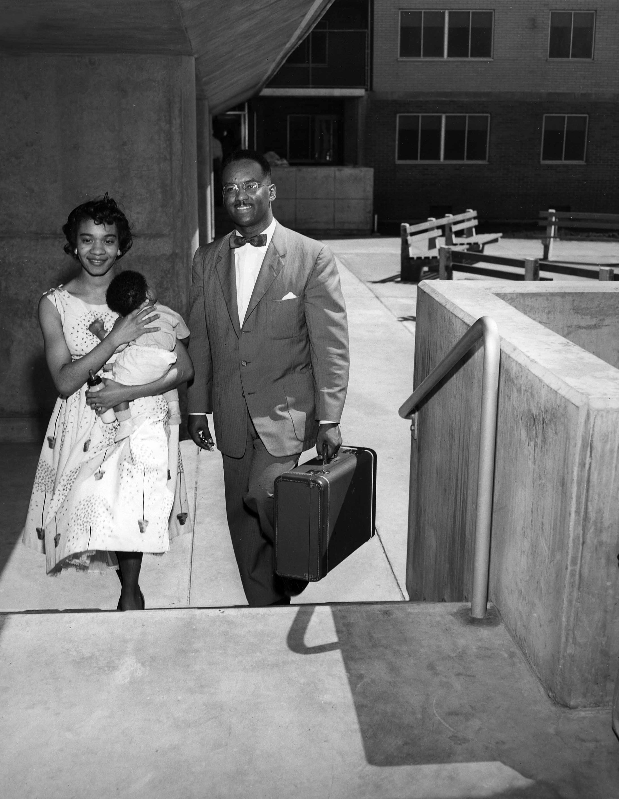 50s couple with baby and suitcase.jpg