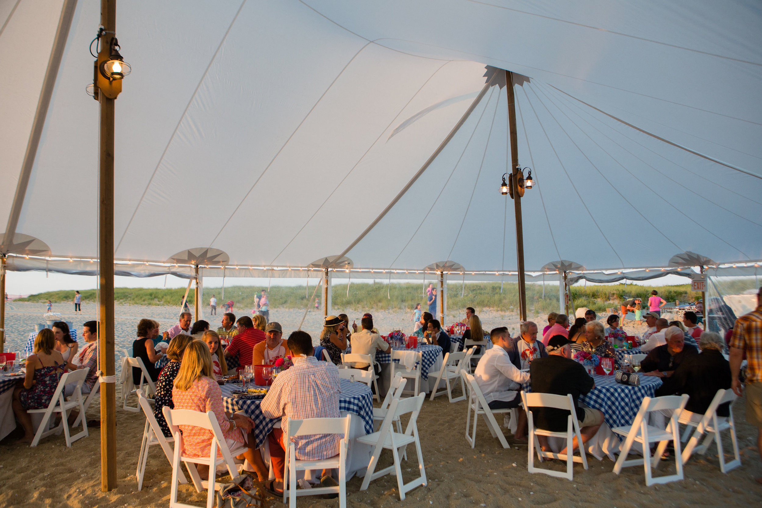 Guests sitting down to a clambake. (photo by JDN Photography)