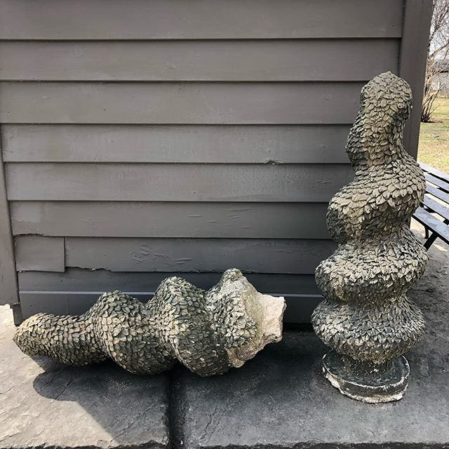 Strange garden finials. One is missing the cement base and no longer sits up straight. $345/pair. #garden #exterior #cement #vintage #home #lawn #entryway #patina #moss #lichen #gardendesign #countryhouse #upstatehouse #grey #yard #sculpture