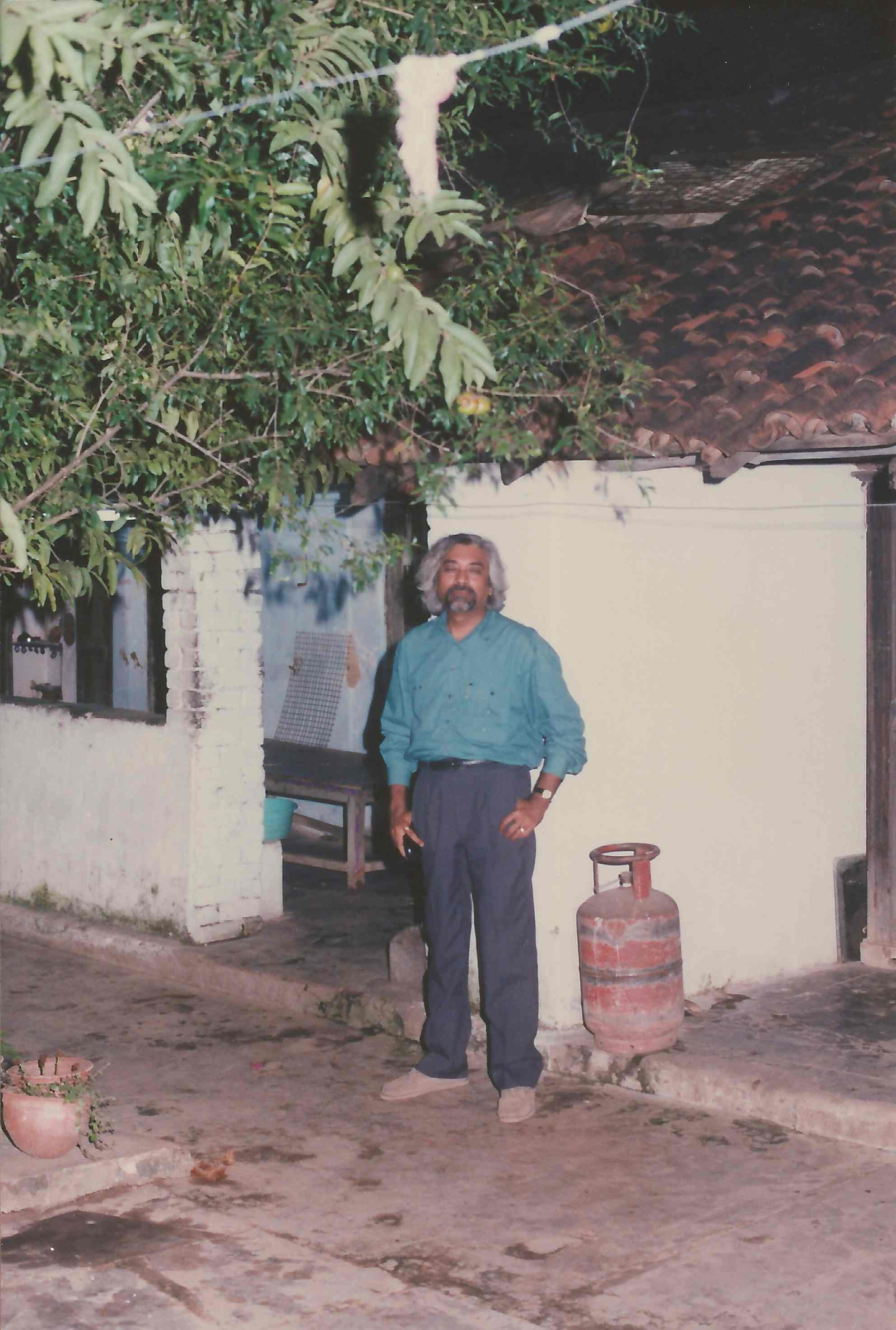 Sam at the house where he was born, Titilagarh, Orissa