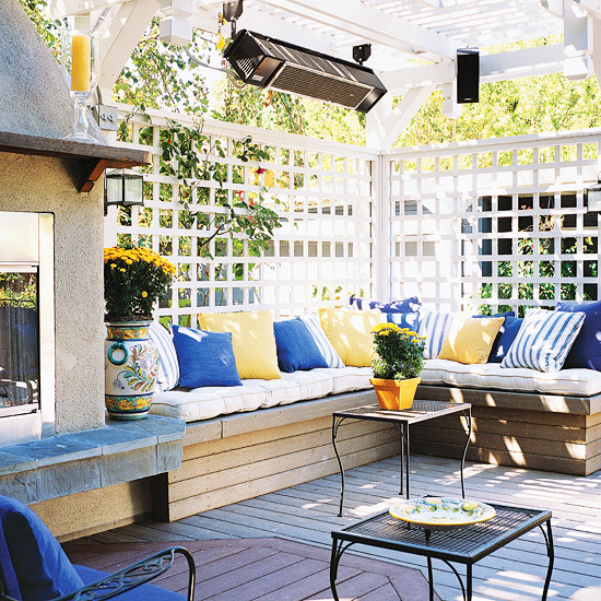 Not only does the lattice create a makeshift wall, but if done correctly it can also create a decorative element in your backyard oasis.   Unlike an actual wall, lattice helps make the space look more open.   Image as seen on www.bhg.com