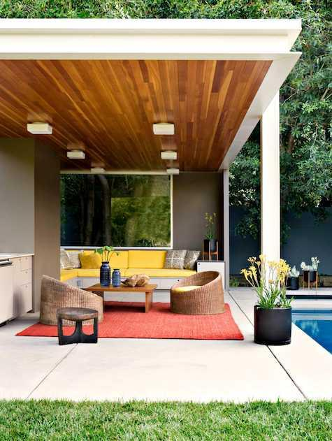 The addition of a colorful rug into this backyard mix adds some dimension to the space.   A decorative floor covering, when utilized correctly, will spice up any area. Image as seen on remodelista.com