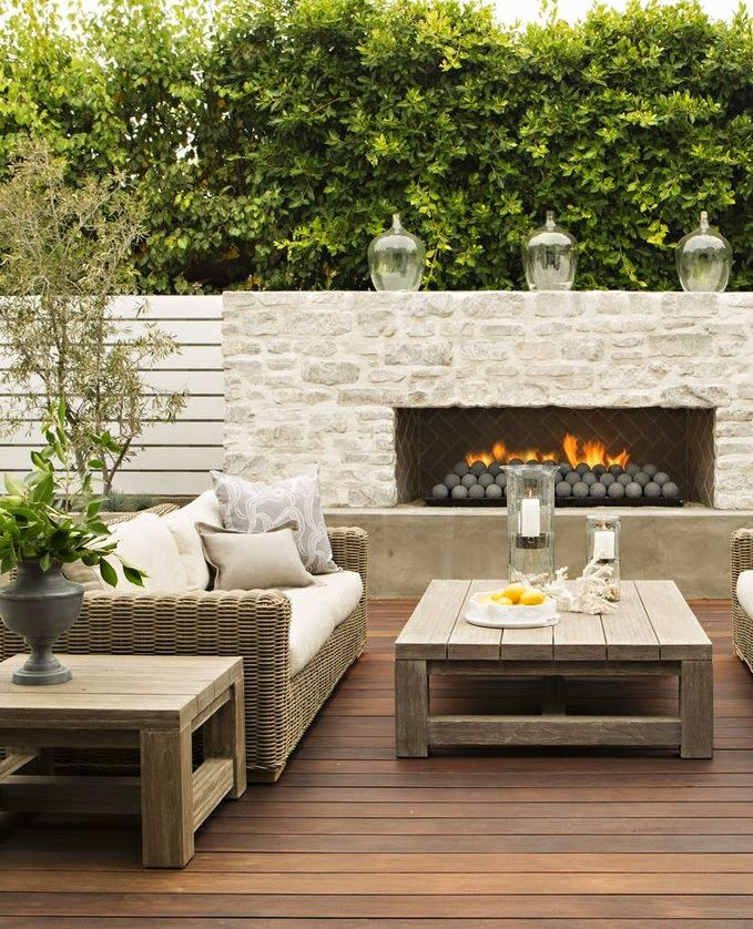 Another benefit of incorporating an outdoor fireplace into your backyard is the added privacy element.   Image as seen on ciaonewportbeach.blogspot.com