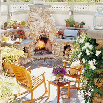 Outdoor fireplaces also tend to accompany an outdoor kitchen area that really ties the whole kitchen zone together.   Image as seen on bhg.com