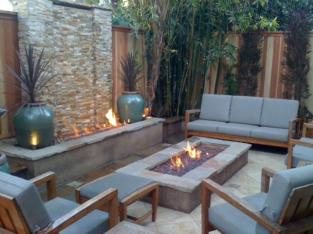 This outdoor area made great use of their space by incorporating both a fireplace and a fire pit into their backyard. Both are functional and decorative elements that work great together. Image as seen on landcapingnetwork.com