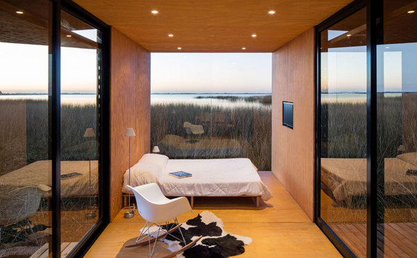 This tiny house was placed in the middle of a field overlooking a lake and really submerses you into the natural surroundings.   Image as seen on homedit.com