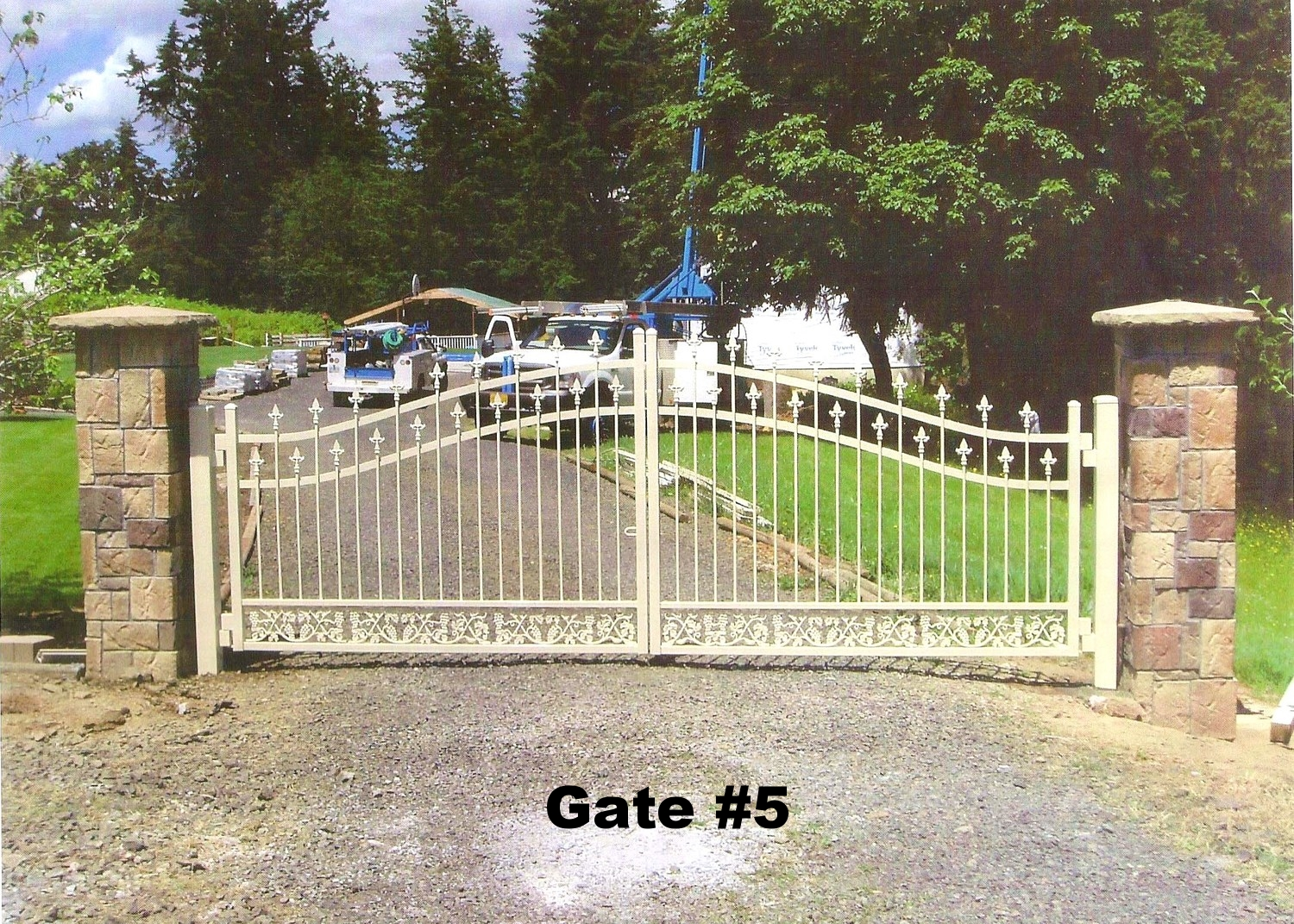 dual swing arched gate with vineyard casting and side pillars