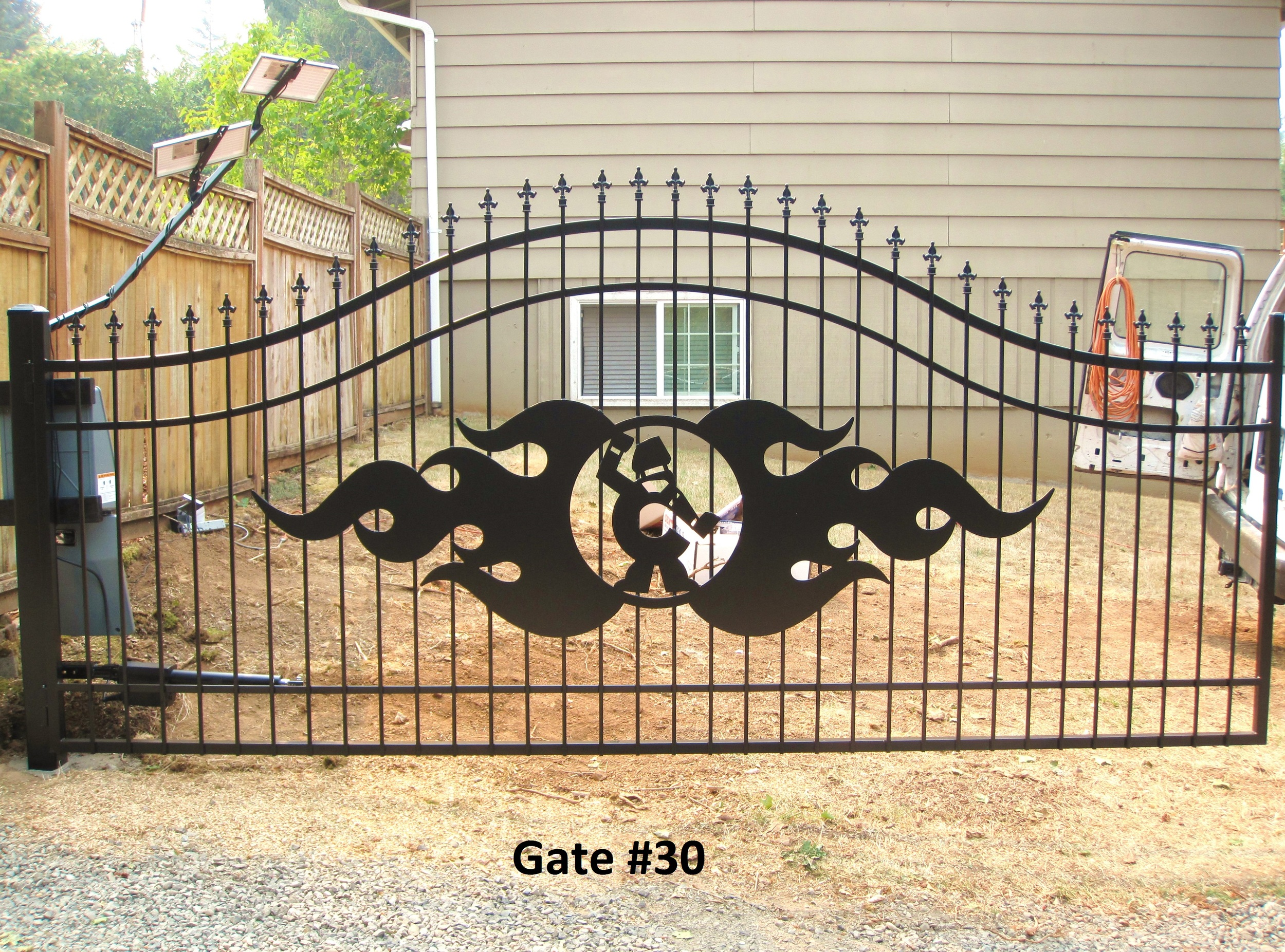 automatic arched single swing gate with laser cut logo
