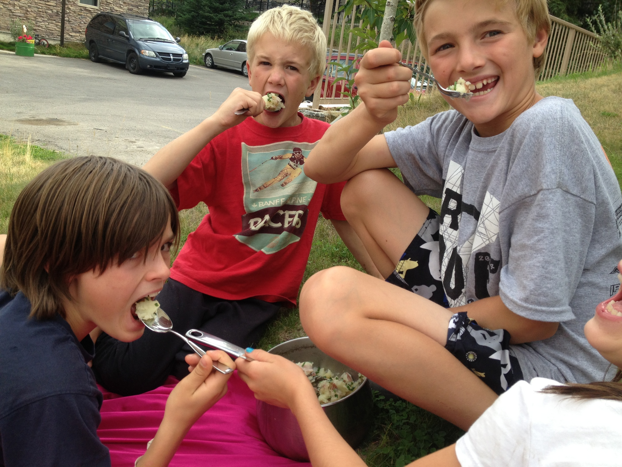 My son and his friends - pretty proud after harvesting the potatoes from our garden and making mashed potatoes. Super proud and super yum!