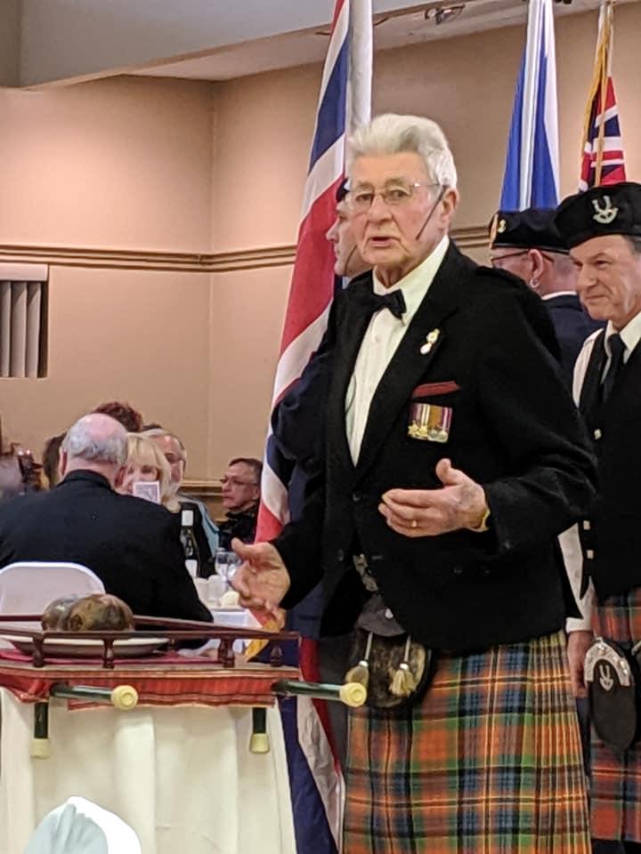 Ex-Pipe Major Bob Dunsmore delivering the Address to a Haggis - Robbie Burns Night 2019