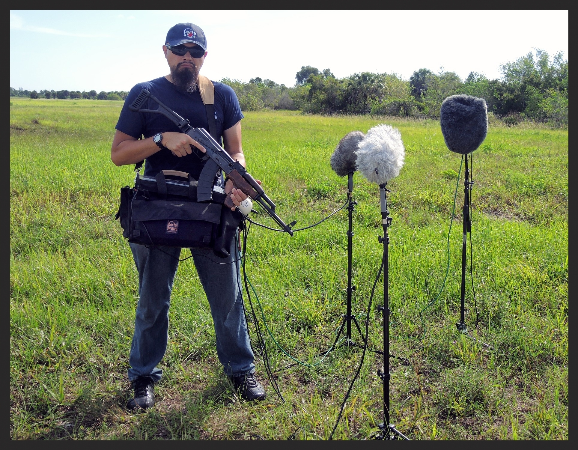 Multi-track field recording an AK-47. It's the same setup I used for the Ferrari session. This time the included strap worked well on my shoulder giving me room to shoot and record at the same time. I DON'T recommend doing this.  Safety is Always Number One!  Hire a professional armorer to do the safe shooting.
