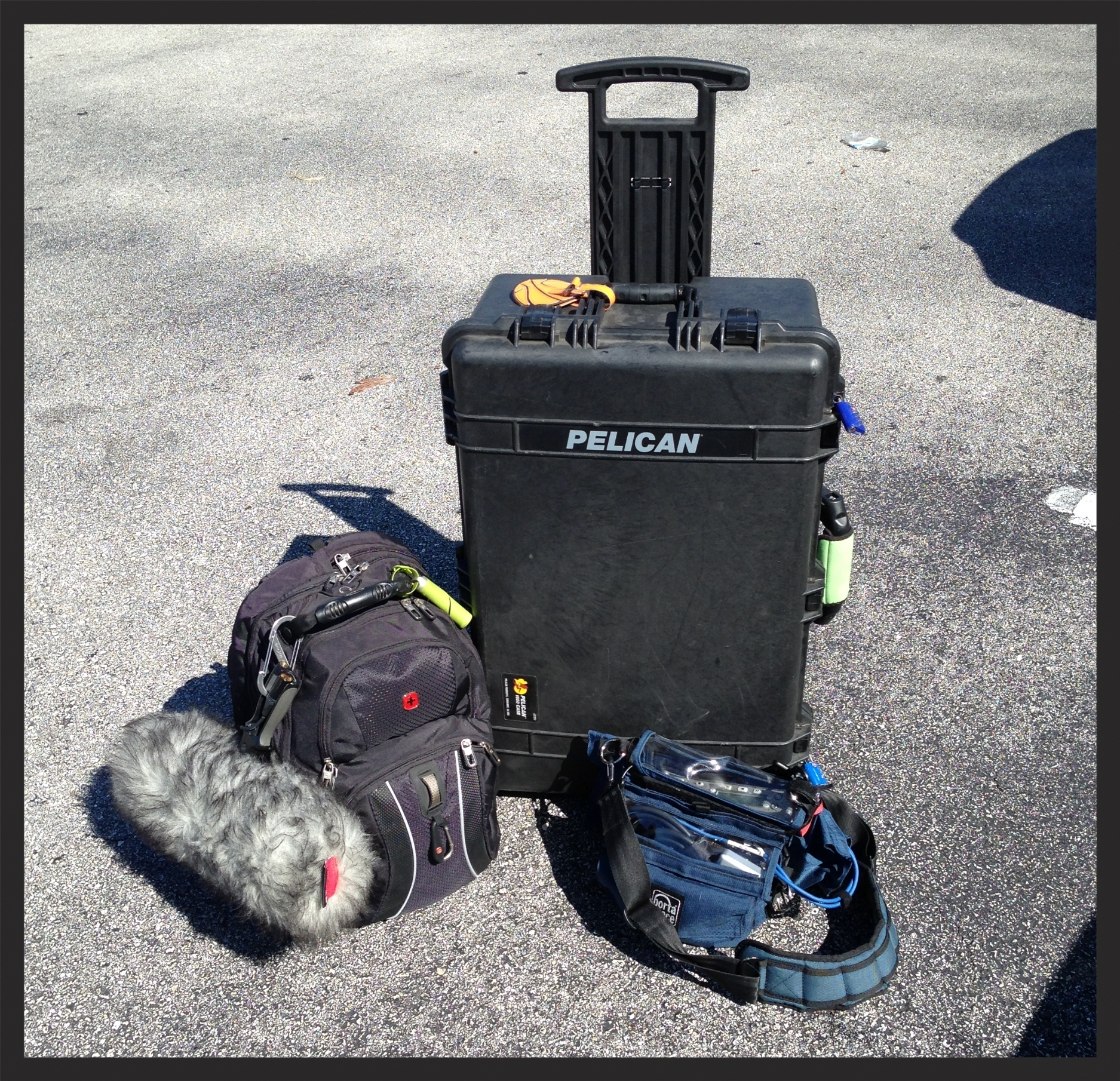In this picture are a Rycote Windshield Kit #4, a large Swiss backpack, a PortaBrace audio bag, and a monster size Pelican 1650 case.  The purpose of this setup is to divide up my equipment. All items outside of the Pelican 1650 case are my primary gear. They are a Sound Devices 744T/MixPre-D inside the PortaBrace bag, my numerous mics, batteries, primary chargers, a camera, gaffers tape, etc all inside the large Swiss backpack.  Inside the Pelican 1650 case, there is a backup 4 track recorder, more batteries, mic stands, cables, zip ties, gaffers tape, clothes, etc items.  I HIGHLY recommend dividing up your precious gear similar to this. Remember to Always have a backup just in case something happens to your primary gear! This applies to other industries such as photography, videography, IT, etc. Stay safe and please share your stories. :-)