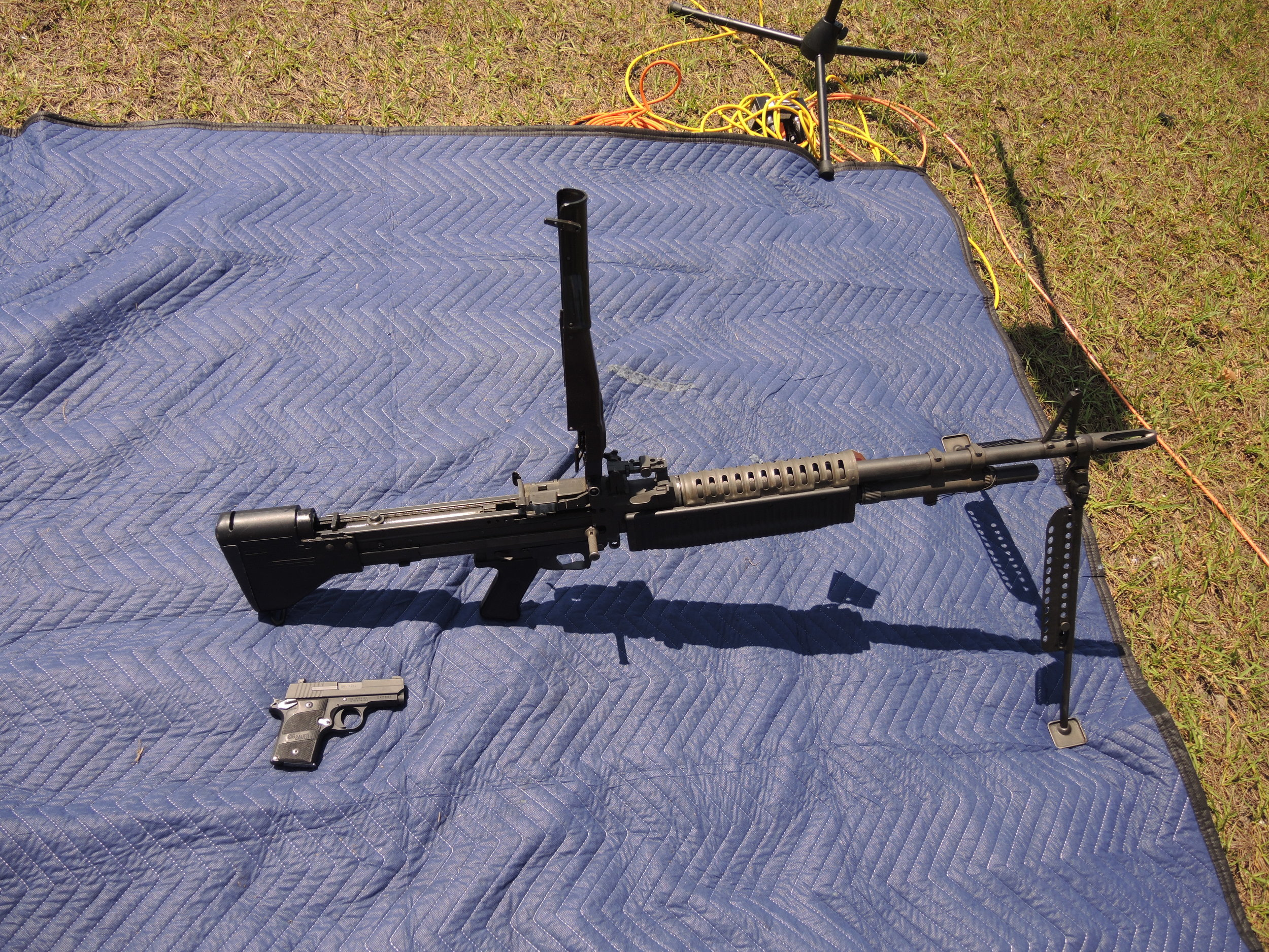 DSCN9968 M60 machine gun vs small 9mm pistol.JPG