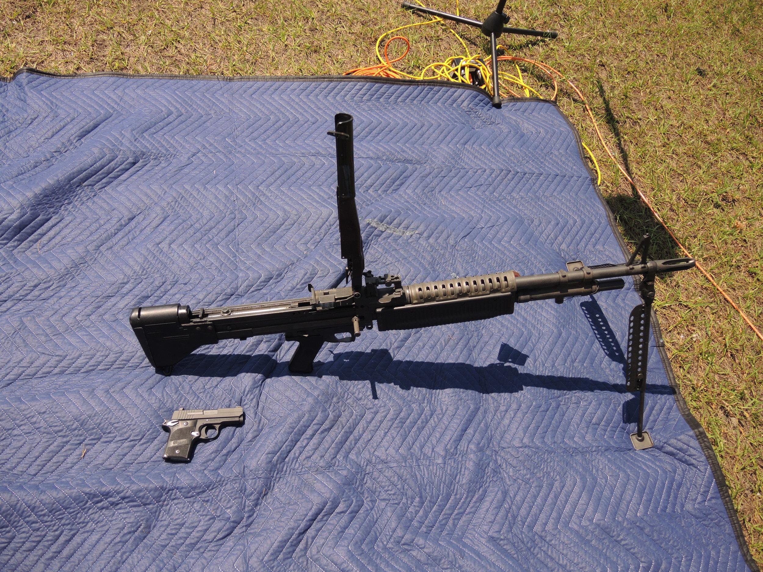DSCN9968 M60 machine gun vs small 9mm pistol.JPG