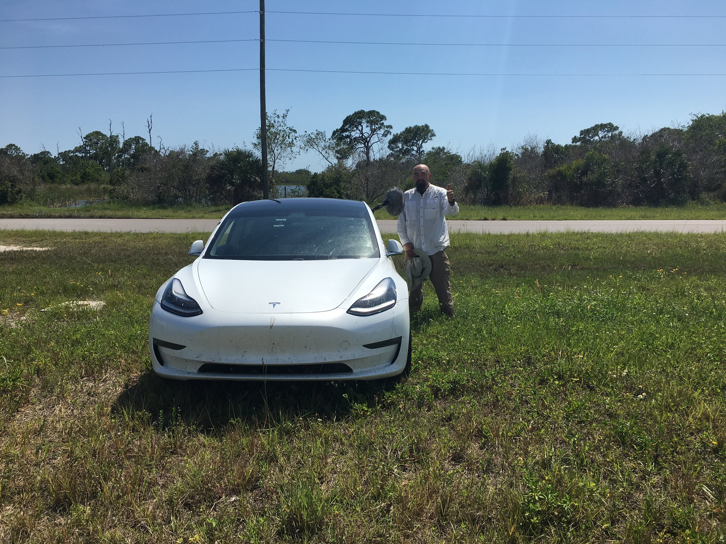 WATSON WITH A   TESLA MODEL 3   ELECTRIC CAR (TO CAPTURE TIRES ON MULTIPLE SURFACES (WITHOUT ENGINE NOR EXHAUST SOUNDS)