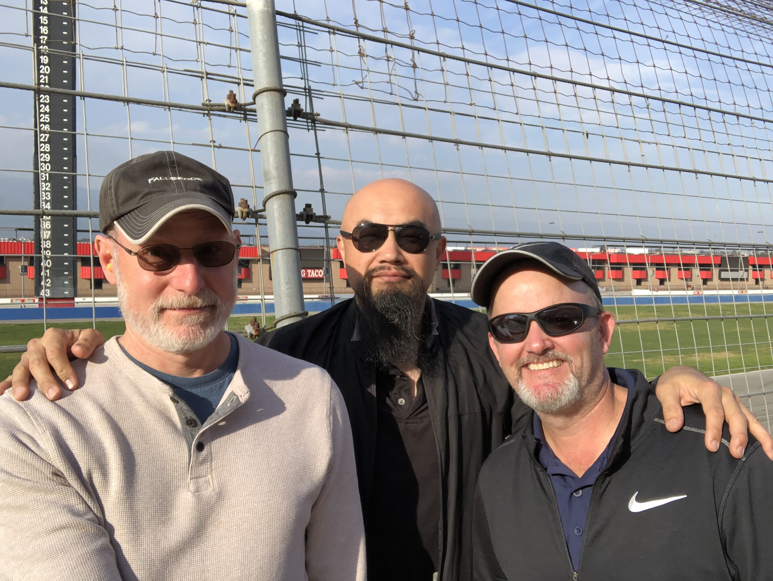 Sound Designer Aaron Marks, Watson Wu, and 704 Games Producer Sean Wilson at Auto Club Race track in Fontana, California
