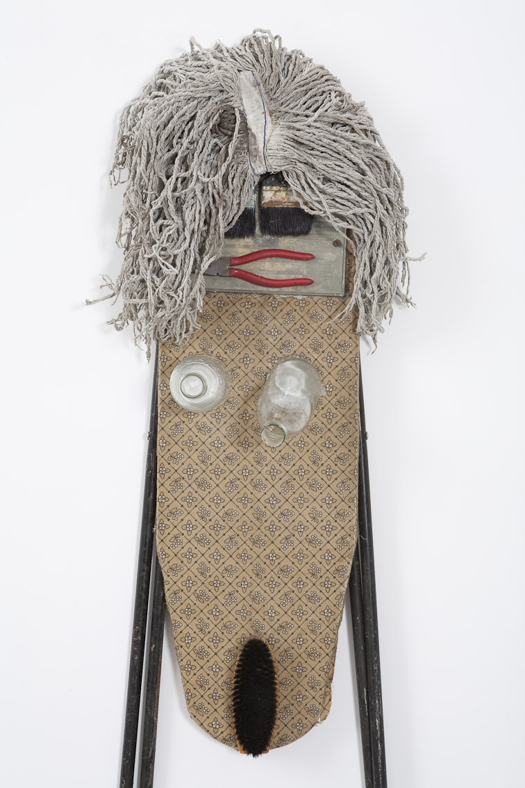 'Madonna' assemblage; ironing board, players, paint brushes, milk bottles, mop, and a hair brush