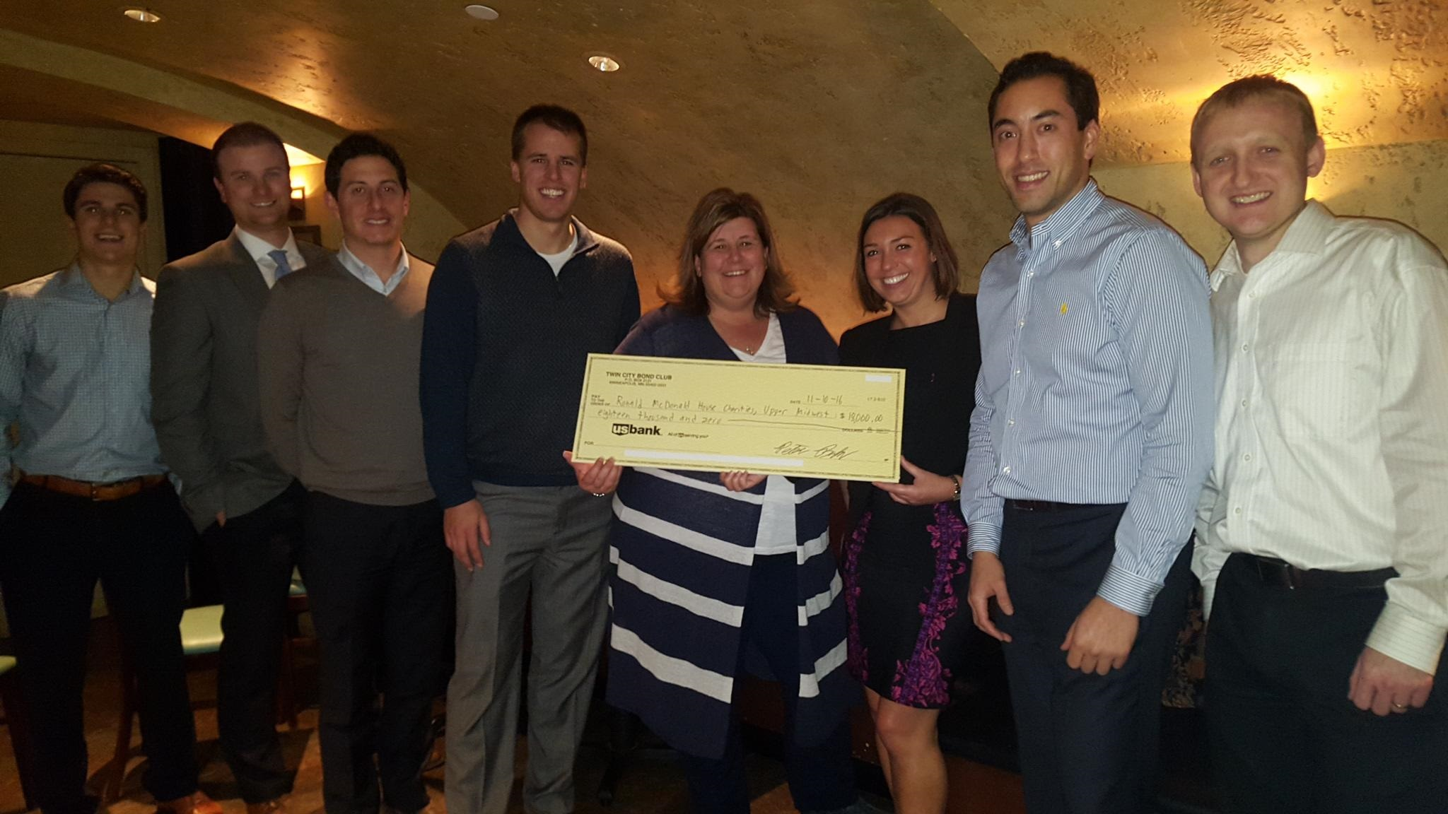 Check for $18,000 given to the Ronald McDonald House Twin Cities