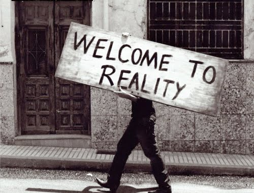 man with reality sign