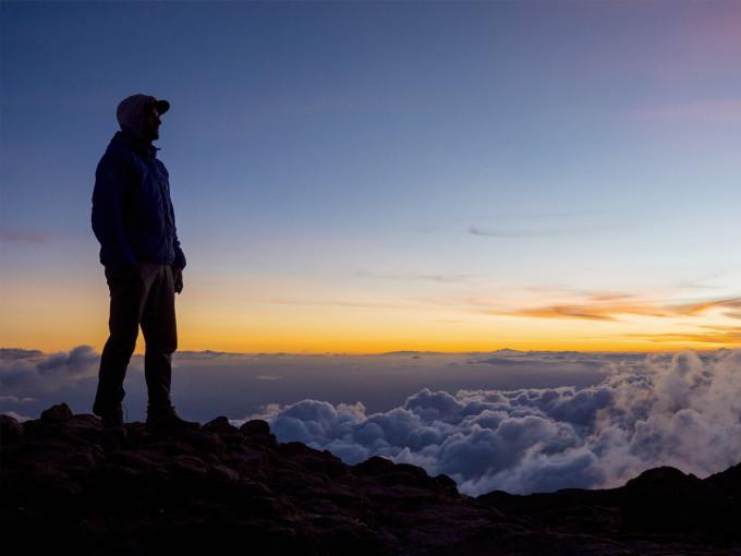 man standing on a mountain peak