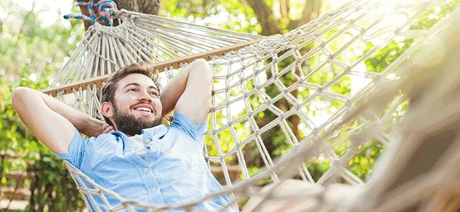 man relaxing in a hammock
