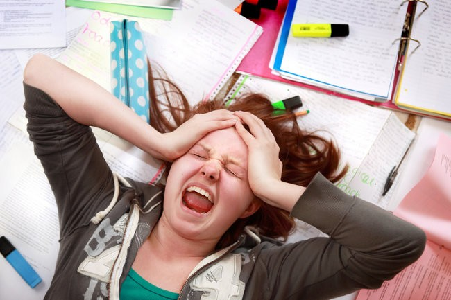 stressed woman lying on top or her work
