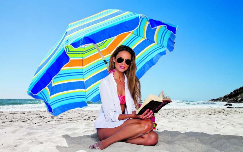 woman reading at the beach