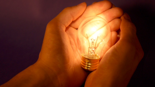 lightbulb in hands