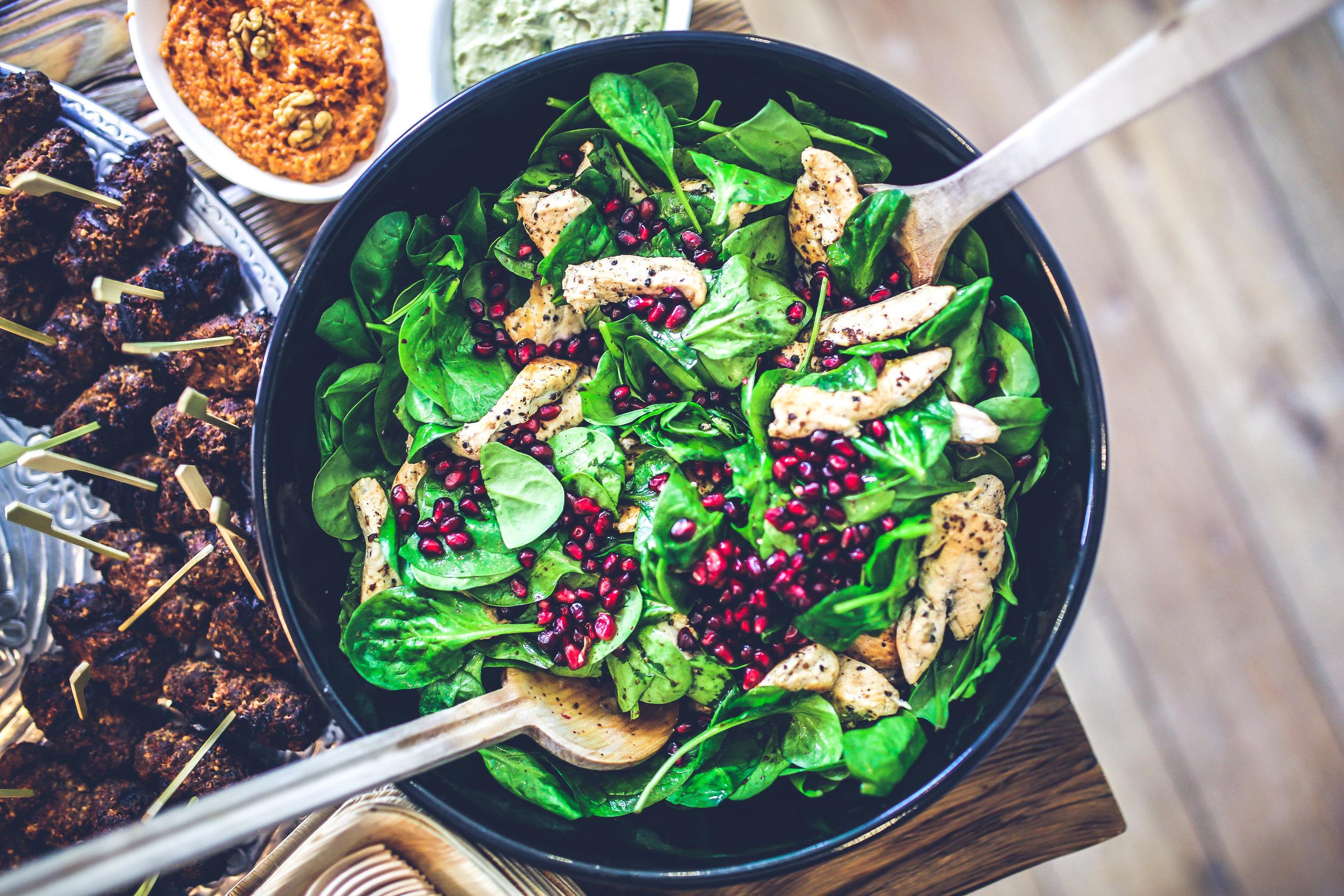 Photo by Kaboompics // Karolina from Pexels  https://www.pexels.com/photo/spinach-chicken-pomegranate-salad-5938/
