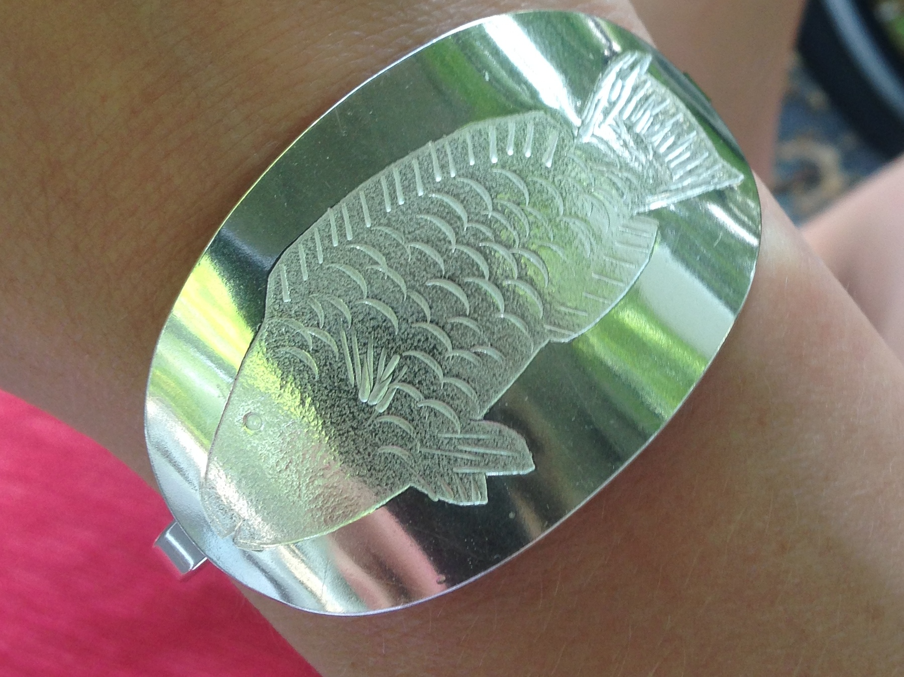 Parrotfish engraved in sterling silver.
