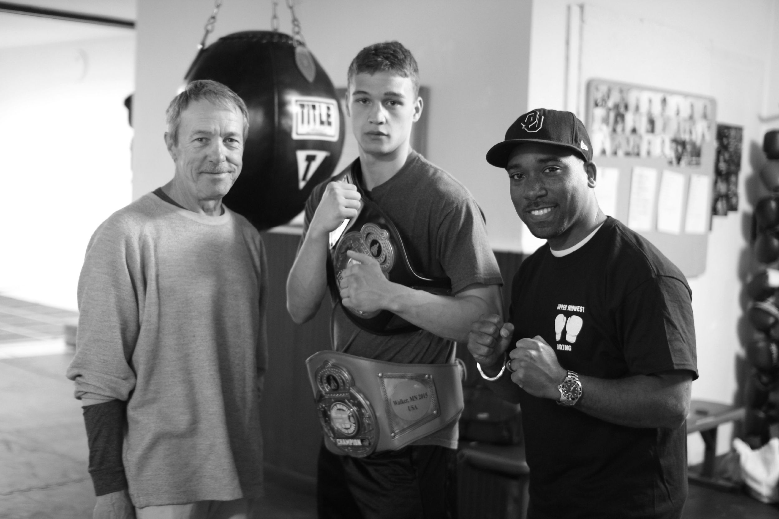 From left, Bill Pomeroy, Justus Pomeroy and Kendric Carter at Lion's Den Boxing in Winona, Minn.
