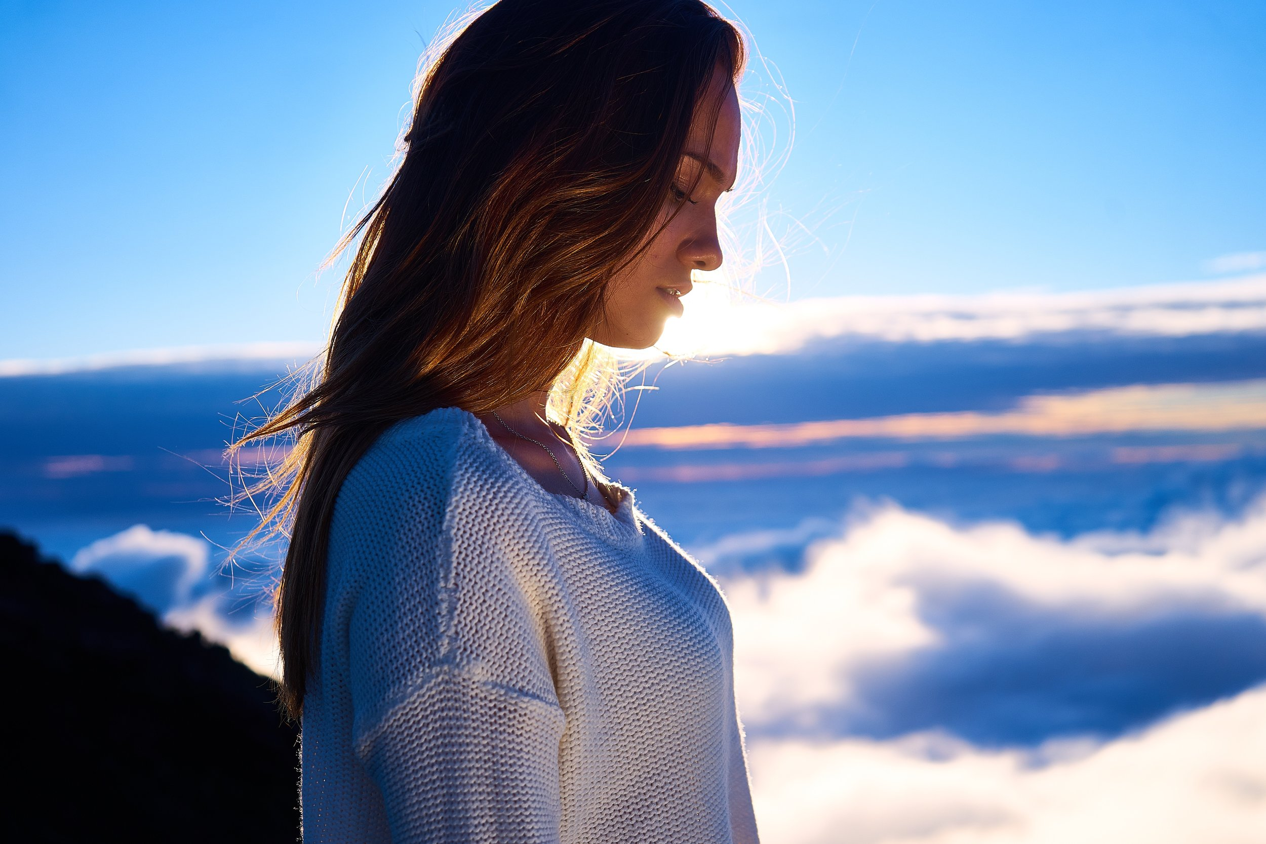 woman looking down at sunset -unsplash.jpg