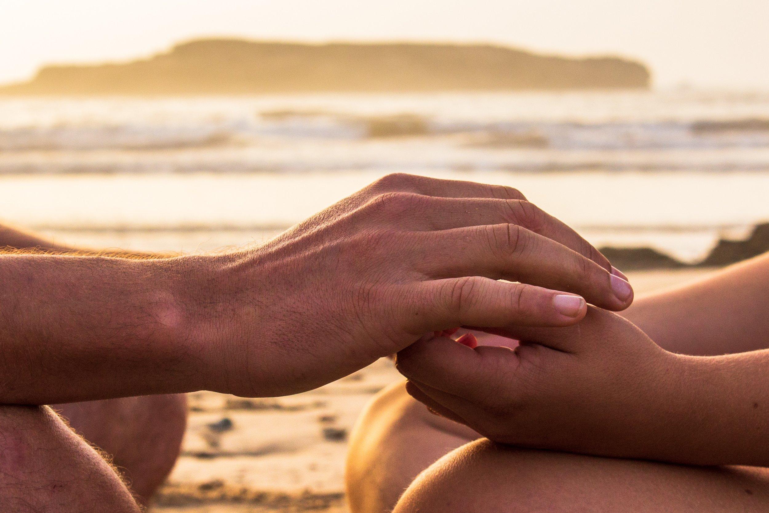 healing hands on knees louis-hansel-7TIUb6CpG_w-unsplash.jpg