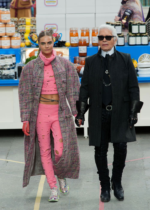 Delevingne is pictured here closing out the A/W 2014 Chanel show alongside head designer and creative director for the fashion house Karl Lagerfeld. (Photo: Elle Canada)