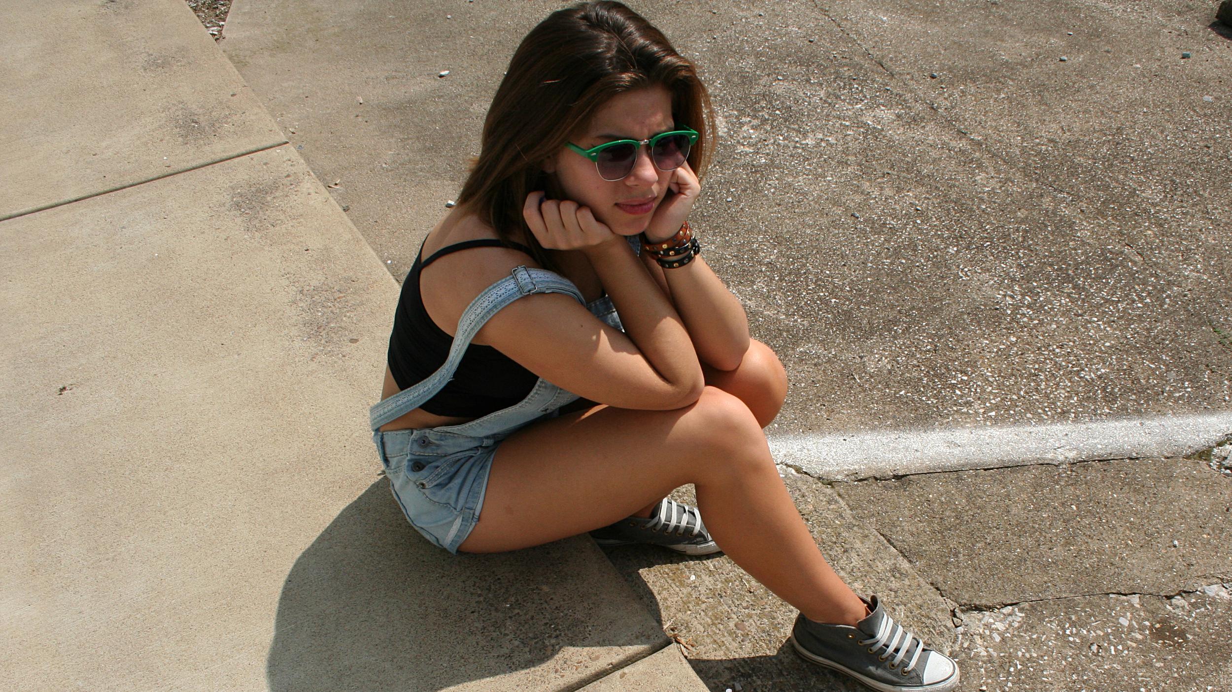 photo: Kae | overalls: Kohl's, black bralet: Forever 21, shoes: Converse