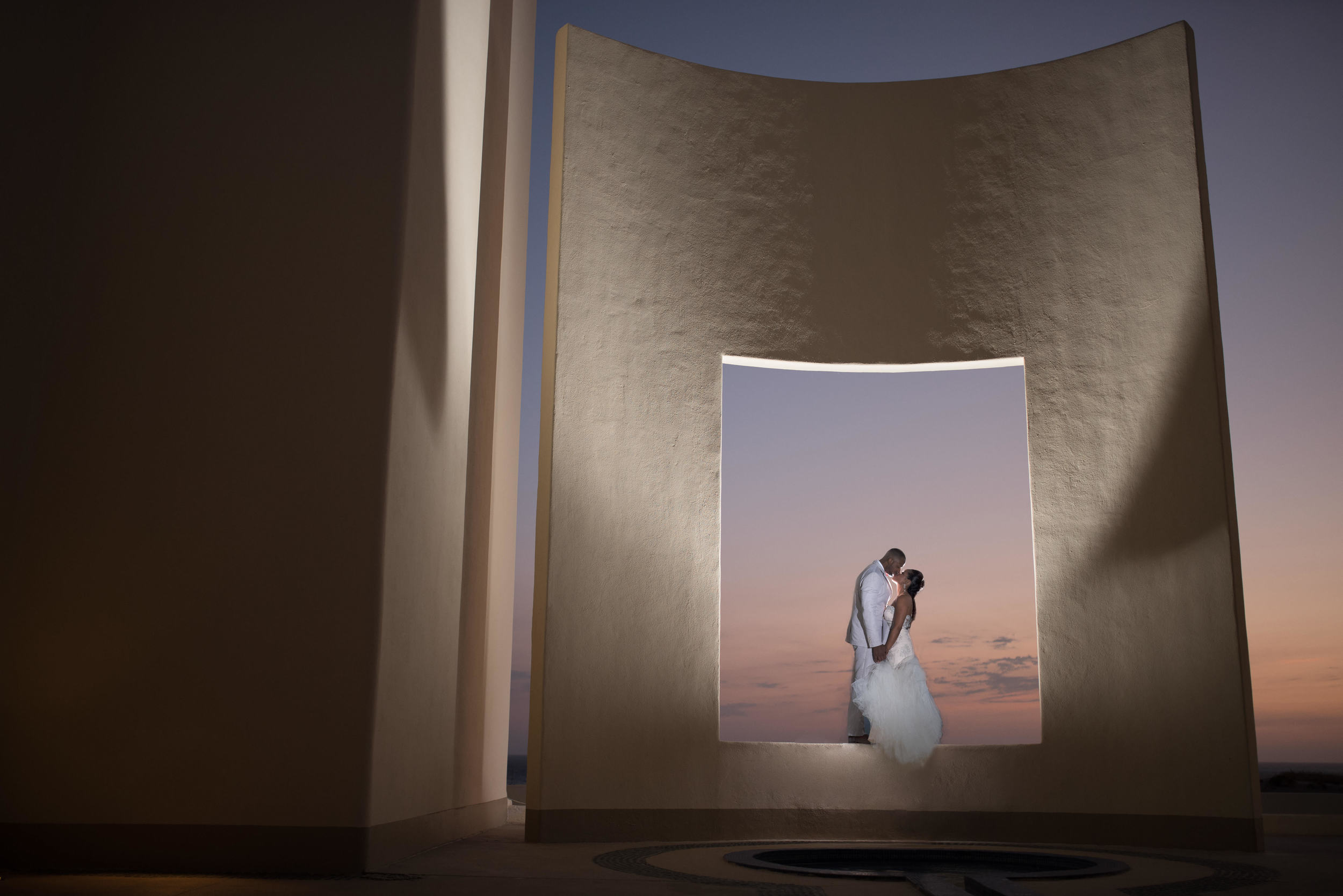 Bride and groom kissing at The Pacific Window at Pueblo Bonito Pacifica. Sunset session with talented GVphotographer