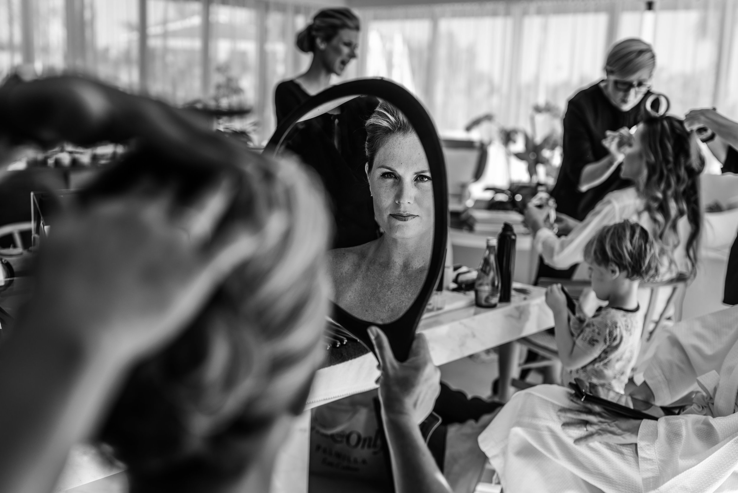 bride getting ready with friends and family