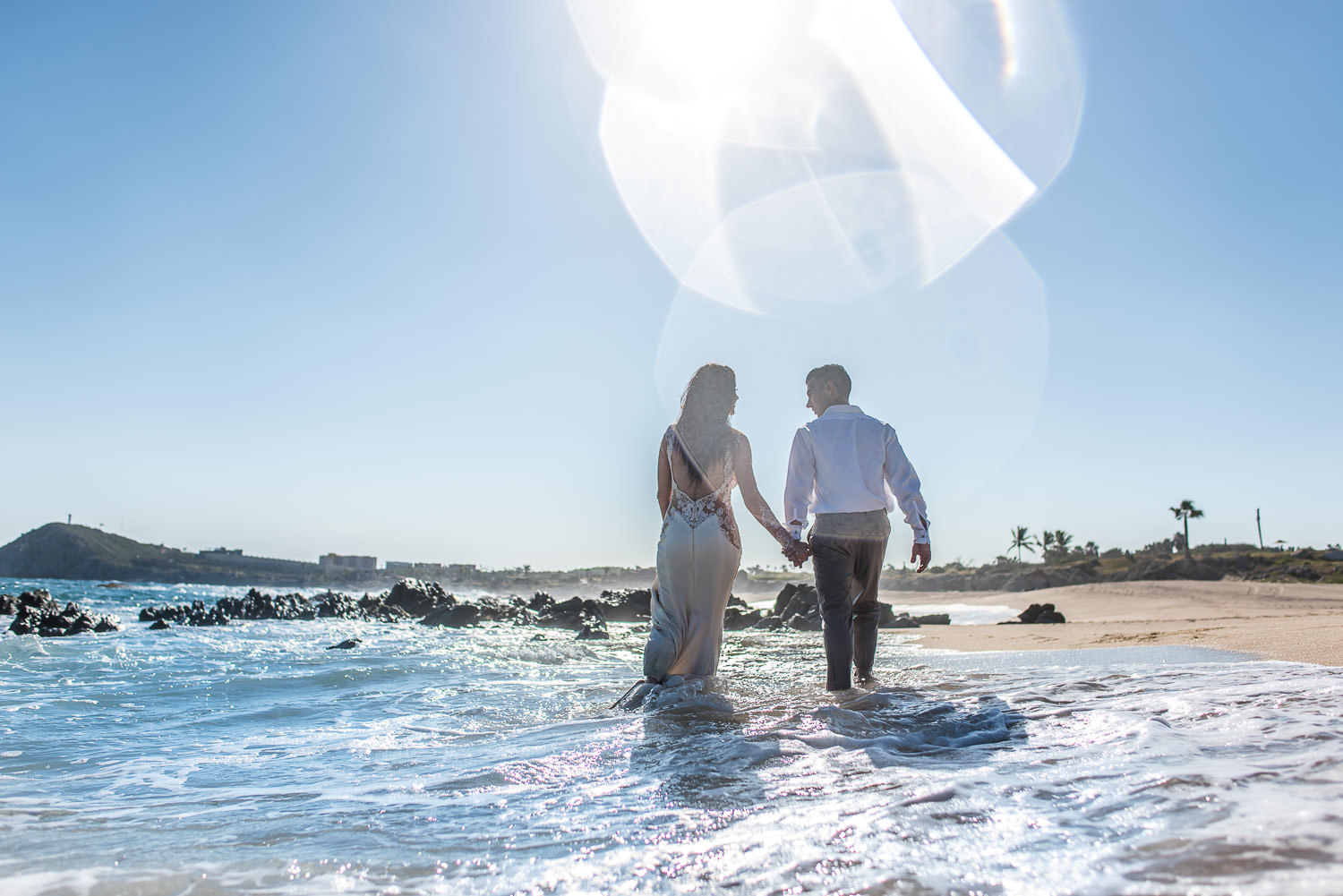 bride and groom during a trash the dress session in Los Cabos
