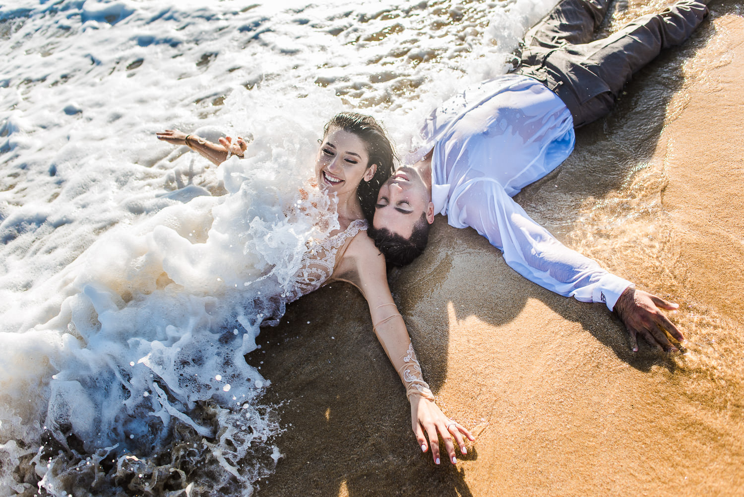 bride and groom having fun with the Ocean