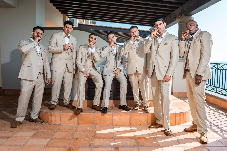 groom and groomsmen smooking cigars before the wedding