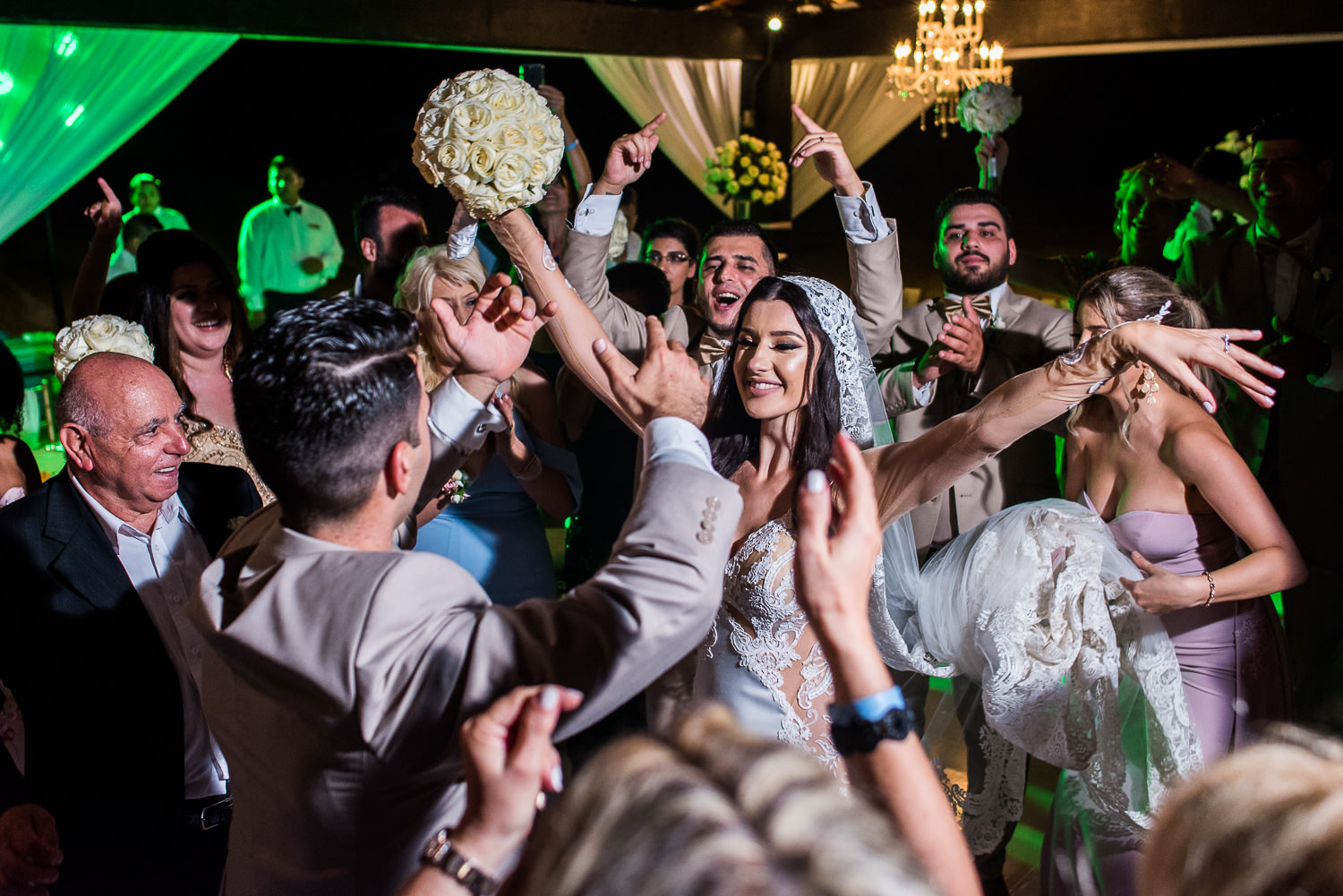 Bride dancing with family and friends