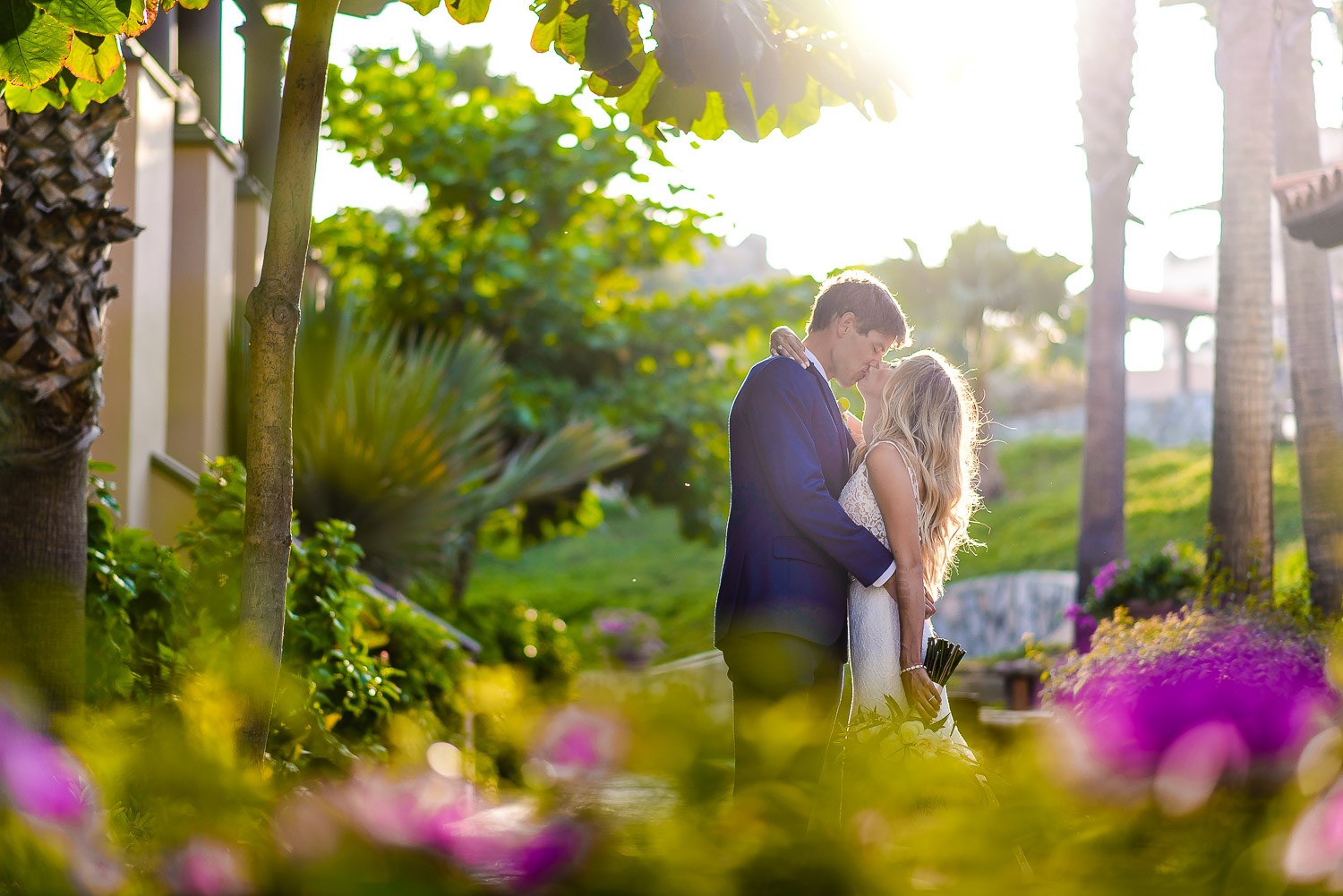 Bride and groom kissing during their photo session with talented GVphotographer at Pueblo Bonito Sunset Beach Los Cabos. GVphotographer is an amazing Los Cabos destination wedding photographer