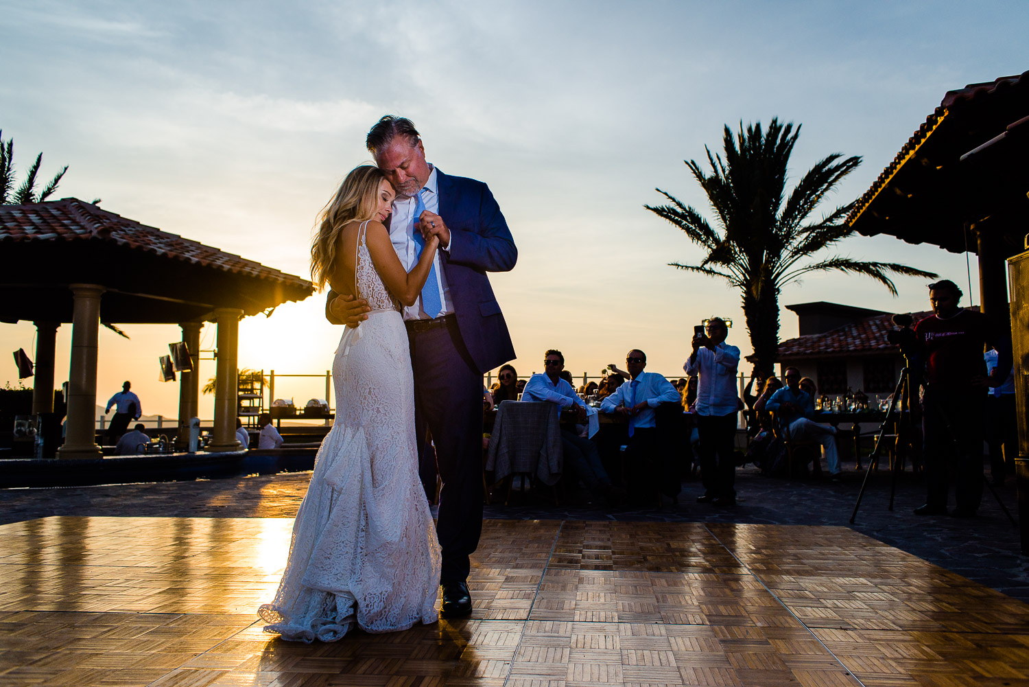 Bride and her father during their first dance at Pueblo Bonito Sunset Beach Los Cabos. GVphotographer is an amazing Los Cabos, Mexico destination wedding professional photographer