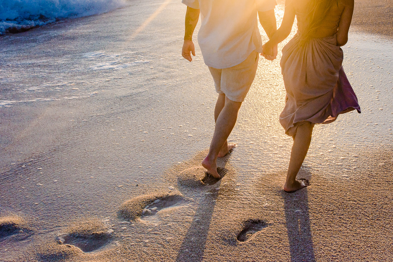 Soon to be Husband and Wife enjoy a sunset walk on a secluded Cabo beach