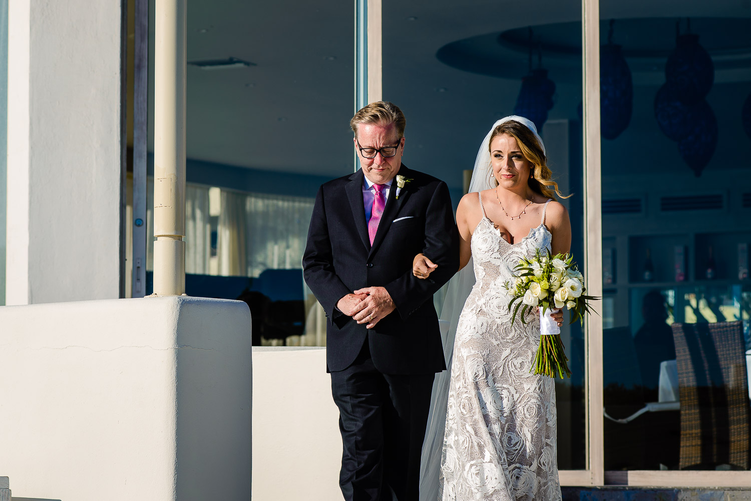 bride and father of the braid during her walking to the aisle
